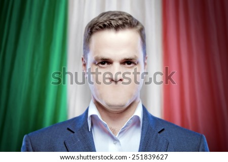 Symbol of censorship and freedom of speech: a young man without a mouth on a background of the national flag of Italy - stock photo