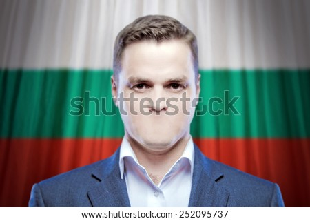 Symbol of censorship and freedom of speech: a young man without a mouth on a background of the national flag of Bulgaria - stock photo
