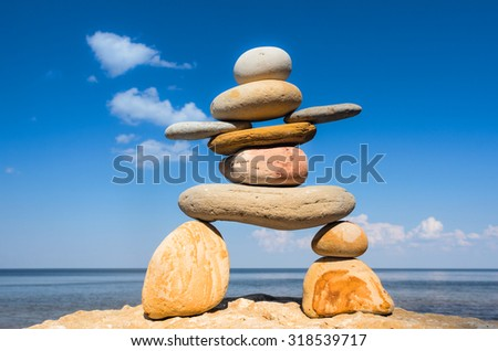 Symbol of Inukshuk on the seashore  - stock photo