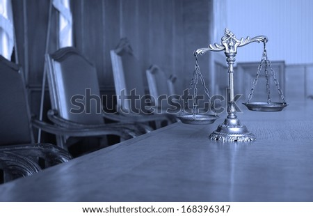 Symbol of law and justice in the empty courtroom, BLUE TONE - stock photo
