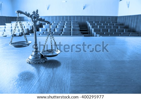 Symbol of law and justice in the empty courtroom, law and justice concept, focus on the scales. BLUE TONE - stock photo