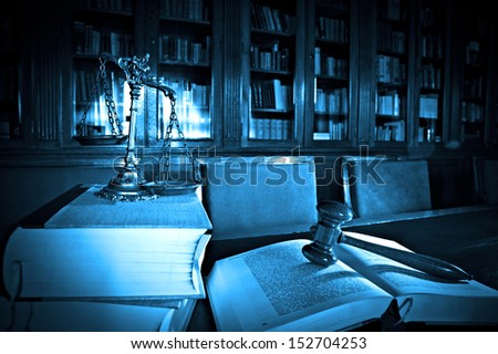 Symbol of law and justice in the library, law and justice concept, blue tone - stock photo