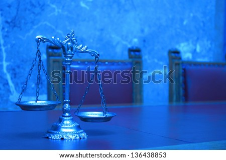 Symbol of law and justice on the table, law and justice concept, BLUE TONE - stock photo