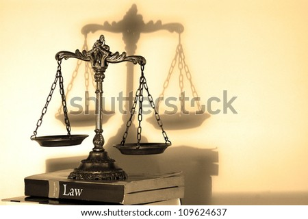 Symbol of law and justice with shadow, law and justice concept, - stock photo