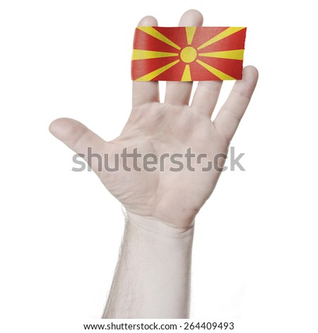 Symbol of national honor: the open palm of the hand with the flag of Macedonia - stock photo