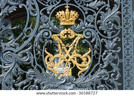 symbol of russian empire at hermitage museum wrought iron gate - stock photo