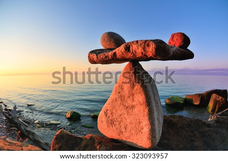 Symbol of scales is made of pebbles on the coast  - stock photo