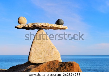 Symbol of scales on the top of boulder - stock photo