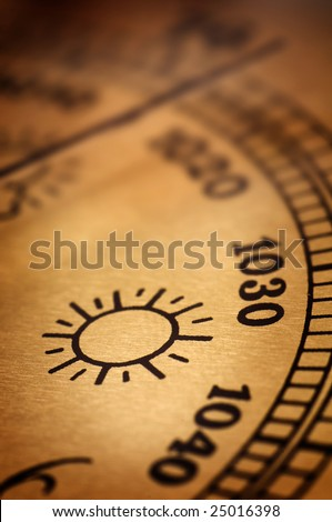 Symbol of sunny weather on an old barometer - stock photo