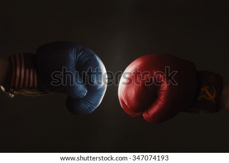 Symbol of the Cold War between America and Russia symbolized with Boxing Gloves - stock photo