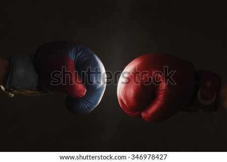 Symbol of the Crisis between Turkey and Russia symbolized with Boxing Gloves - stock photo