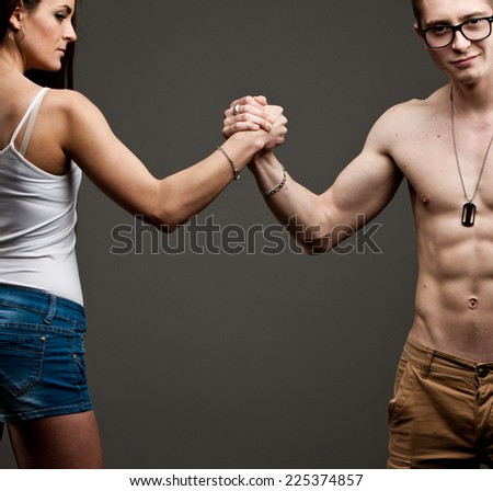 symbolic conflict of men VS women in the eternal conflict of women against men - stock photo