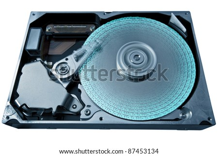symbolic detail of a opened hard disk and some data, blue toned - stock photo