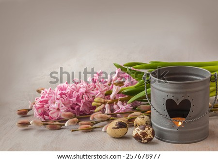 Symbolic Easter background with branches of willow, eggs and burning candle - stock photo