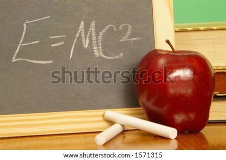 Symbolic equation on a school slate. - stock photo