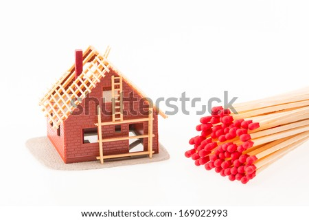 Symbolic image for fire insurance and arsonists - stock photo