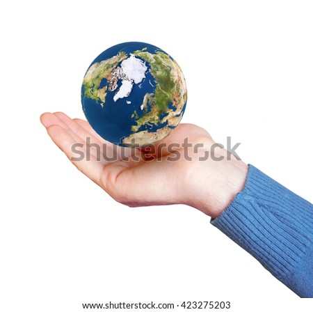 symbolic image of a hand which holds the planet - stock photo