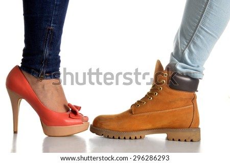 Symbolic image of a pair of shoes for woman and a pair for male - stock photo