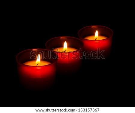 Symbolic remembrance candles - votive, All Saints Day etc. - stock photo