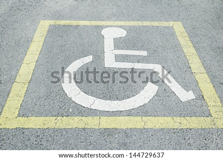 Symbols drawn road handicapped parking and signage - stock photo