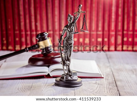 Symbols of law in court  library. Judge gavel, goddess of justice Themis and legal codes. Law concept - stock photo