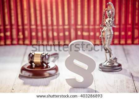 Symbols of law in court library with legal codes. Law concept - stock photo