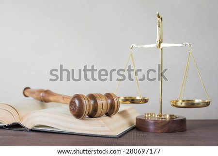 Symbols of law: wood gavel, soundblock, scales and opened volumetric old books, with space for text - stock photo