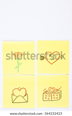 Symbols of Valentines Day on yellow sheet of paper lying on white background, symbol of love, copy space for text - stock photo