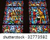 Symbols of war and peace in a stained-glass window in the National Cathedral in Washington DC Vault in the lower level (Crypt) of the National Cathedral in Washington DC - stock photo
