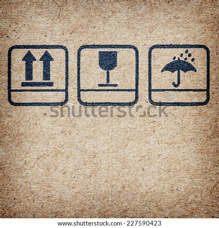 symbols on Cardboard ,  logo on recycled paper background. - stock photo