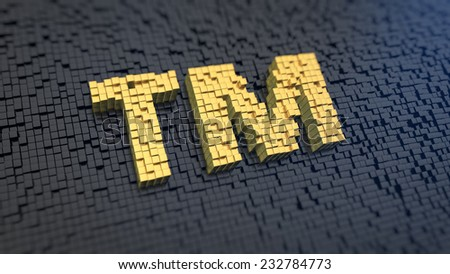 Symbols 'tm' of the yellow square pixels on a black matrix background. Trademark concept. - stock photo