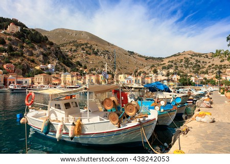 SYMI ISLAND, GREECE - JUNE 11, 2016: Fishing boats in picturesque harbor on the island of Symi in Agean Sea. - stock photo