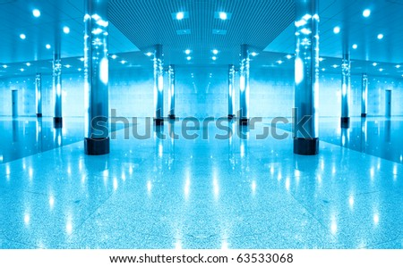 symmetric modern hall inside office center - stock photo