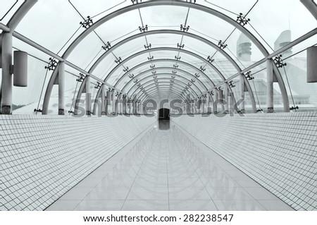 symmetric vanishing corridor with bent wall - stock photo