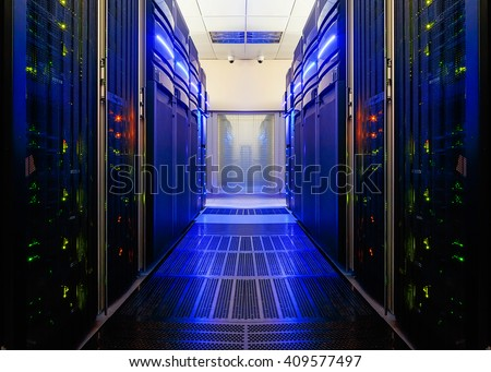 symmetrical data center room with futuristic beams and rows of equipment - stock photo