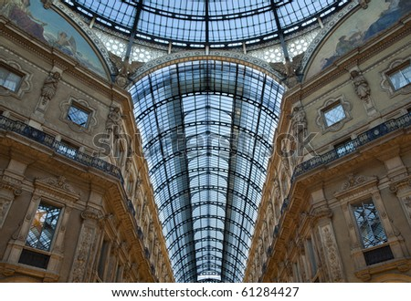 Symmetrical shot of the famous Galleria Vittorio Emanuele II in Milan, Italy, showing the spectacular glass roof - stock photo