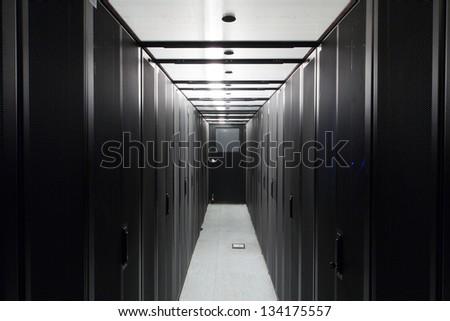 Symmetrically telecommunication racks in a sealed corridor. - stock photo