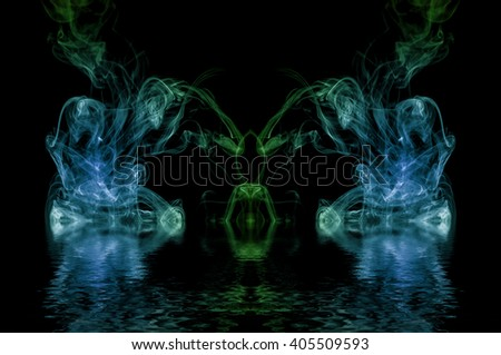 Symmetry abstraction on a black background reflected in water surface. - stock photo