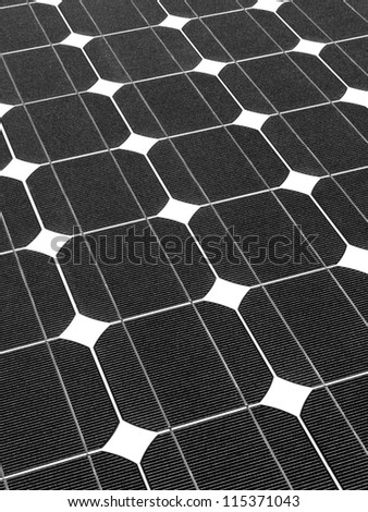 Symmetry of solar panel in black and white - stock photo