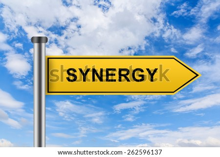 synergy words on yellow road sign on blue sky - stock photo