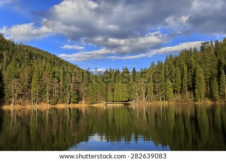 Synevyr lake - deepest in the Urainian carpathian mountains at sunset
