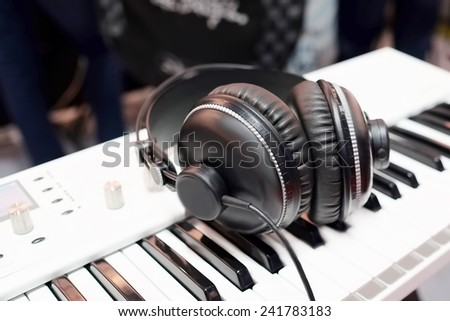 synthesizer and headphones under the white background - stock photo