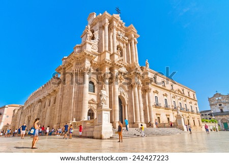 SYRACUSE, ITALY - AUGUST 16, 2014: tourists and locals visit main square Piazza del Duomo in Ortigia, Syracuse, Italy. Ortigia is a small island which is the historical centre of the city of Syracuse - stock photo