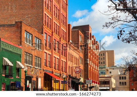 SYRACUSE, NY - NOVEMBER 29: Walton Street is part of Armory Square, a revitalized district in downtown Syracuse, New York, with shops, eateries, and entertainment. Photo taken on November 29, 2013. - stock photo