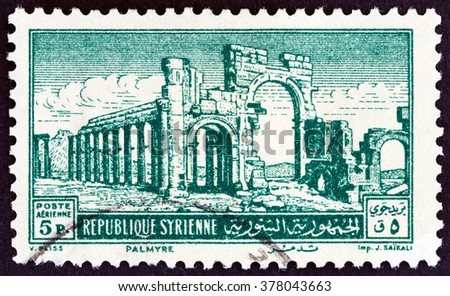 SYRIA - CIRCA 1952: A stamp printed in Syria shows the Monumental Arch, Palmyra, circa 1952. - stock photo