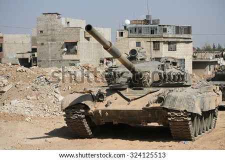 Syria, Damascus, September 2013. Tank Syrian national army is close to a war zone in the city of Damascus. - stock photo