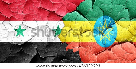 Syria flag with Ethiopia flag on a grunge cracked wall - stock photo