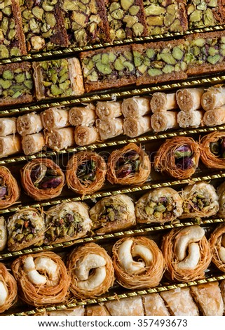 Syrian pastry with pistachios and nuts in a pastry box - stock photo