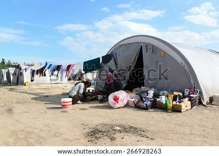 http://thumb101.shutterstock.com/display_pic_with_logo/2281994/266928263/stock-photo-syrian-people-in-refugee-camp-in-suruc-these-people-are-refugees-from-kobane-and-escaped-because-266928263.jpg