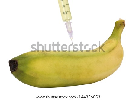 Syringe being injected into a banana - stock photo